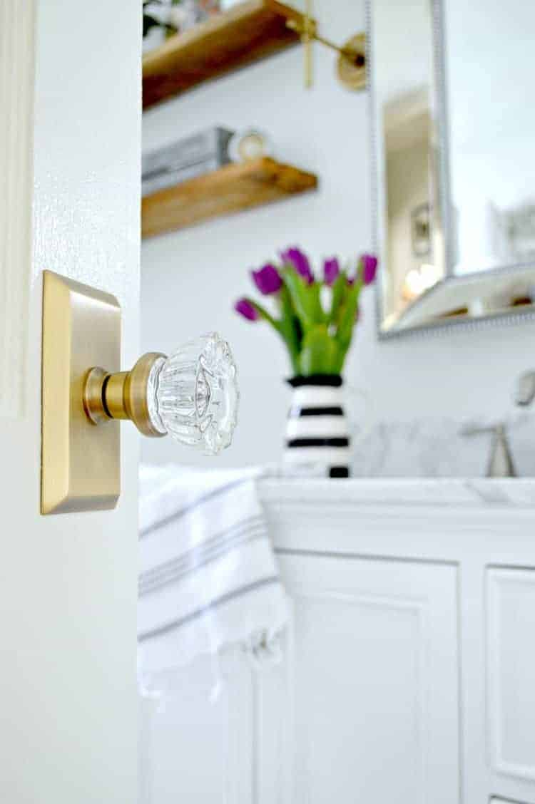 Updating old doors in a cottage bathroom with some elbow grease, paint and beautiful new glass door knobs. A quick and easy DIY to add vintage charm to your home. | Chatfield Court