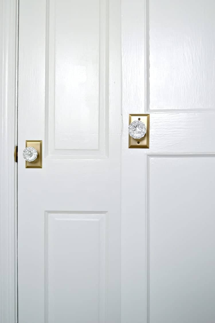 Updating 2 old doors in a stone cottage bathroom with some elbow grease, paint and beautiful new glass door knobs. A quick and easy DIY to add vintage charm to your home. | Chatfield Court