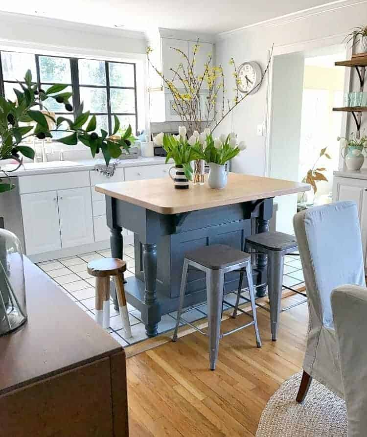 Change up the look in the kitchen and dining room with painted black window frames. An easy and inexpensive DIY project. | Chatfield Court
