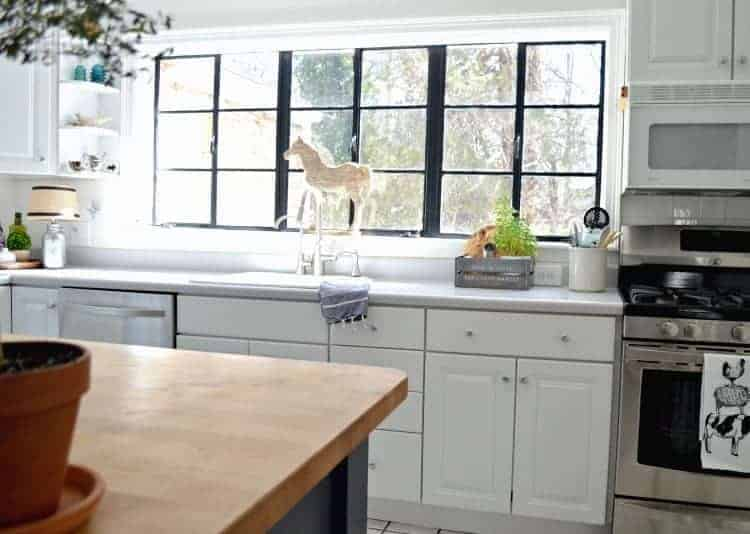 Change up the look in the kitchen with painted black window frames. An easy and inexpensive DIY project. | Chatfield Court