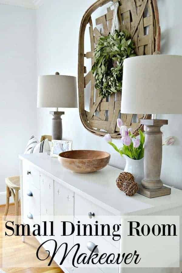 white buffet in small dining room with wood lamps