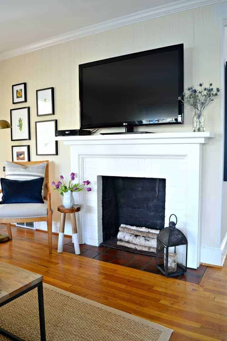 Easy makeover completed on a brick fireplace using paint.