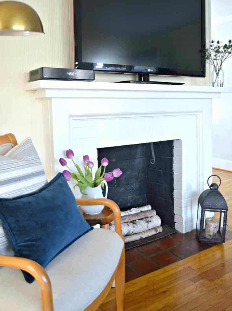 A super easy DIY brick fireplace makeover that can be done in a few hours with just a little bit of paint | Chatfield Court