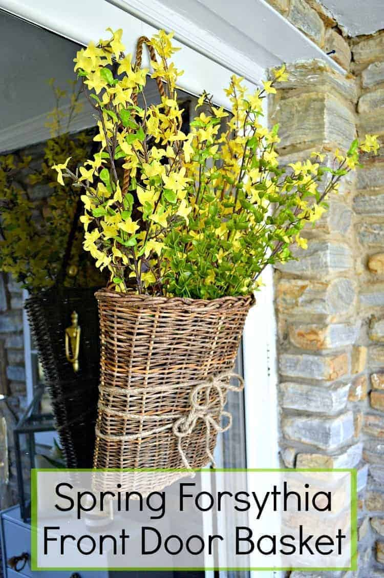 A spring forsythia basket hanging on a front door