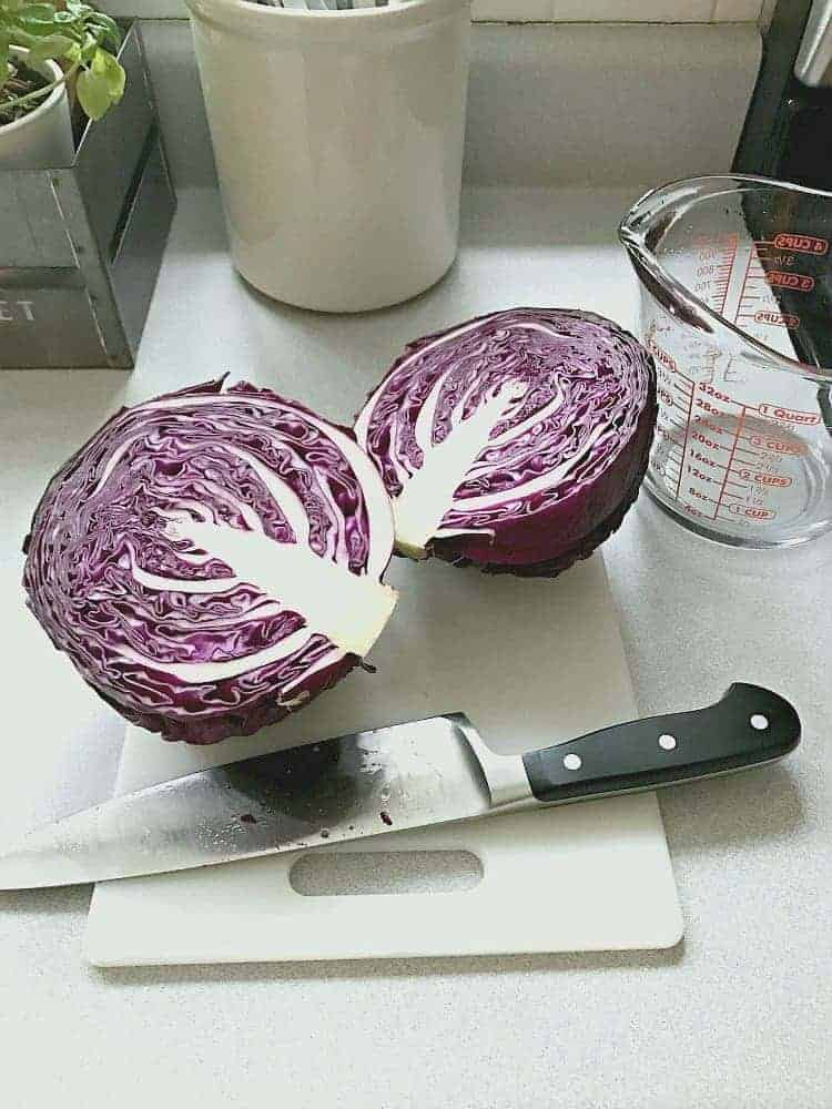 red cabbage cut in half on cutting board
