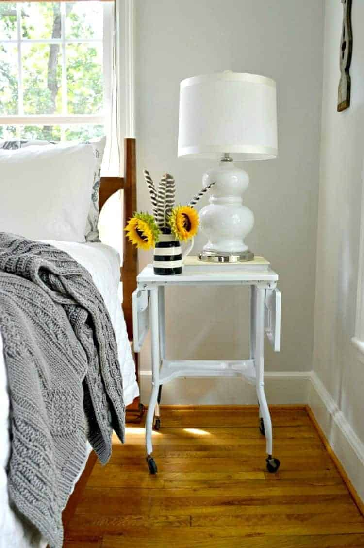 Adding a small DIY nightstand to a small master bedroom.