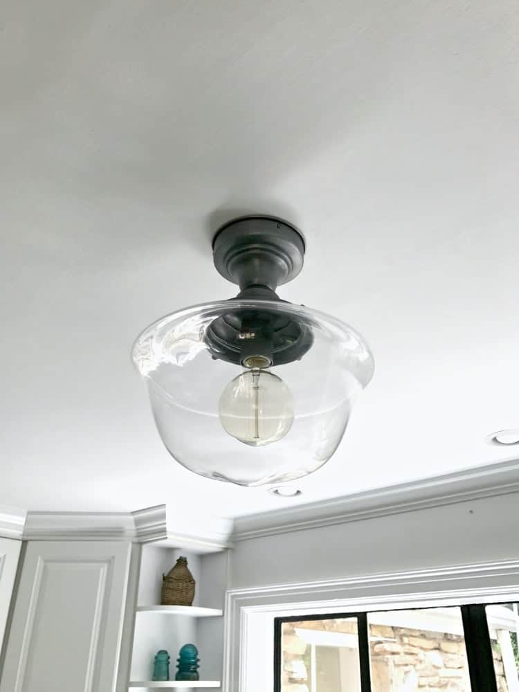 Installing a new kitchen ceiling light to add a bit of farmhouse charm to a small space. | Chatfield Court