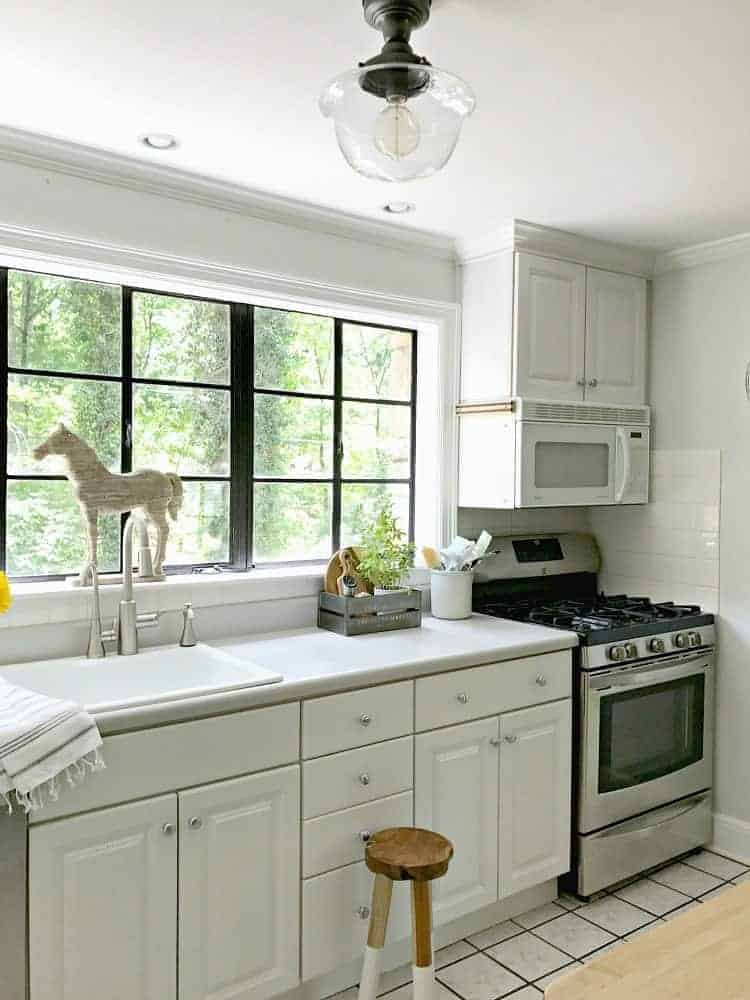 Removing an old fluorescent light and installing a new kitchen ceiling light to add a bit of farmhouse charm to a small space. | Chatfield Court