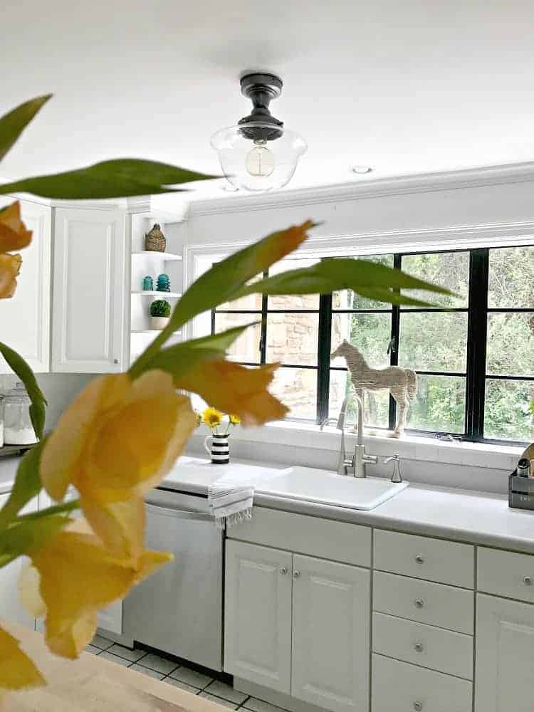 How to install a new kitchen ceiling light to add a bit of farmhouse charm to a small white kitchen. | Chatfield Court