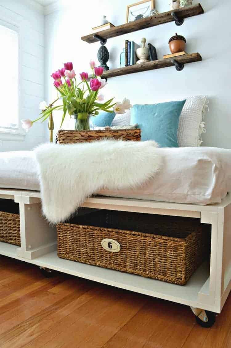 DIY platform bed with tons of storage and wheels so you can move it. So clever!