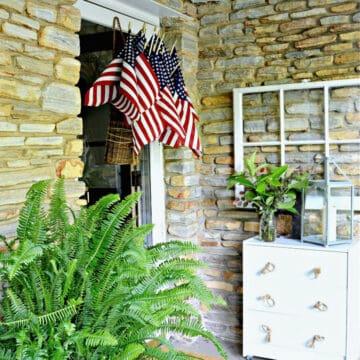 American flags in hanging basket on front door