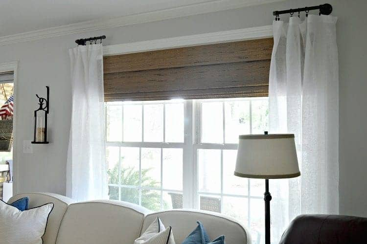 How to customize your room by making DIY custom curtain rods for the living room using black pipe and fittings.
