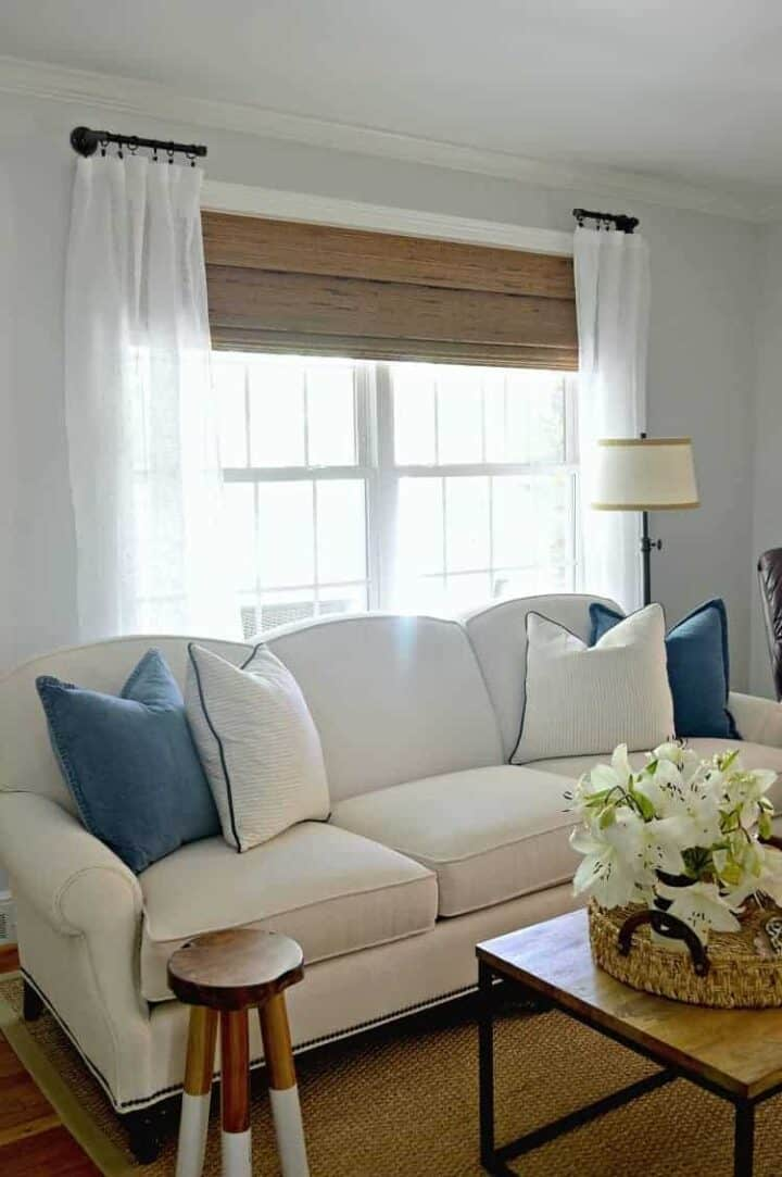 new white living room sofa with blue and white pillows