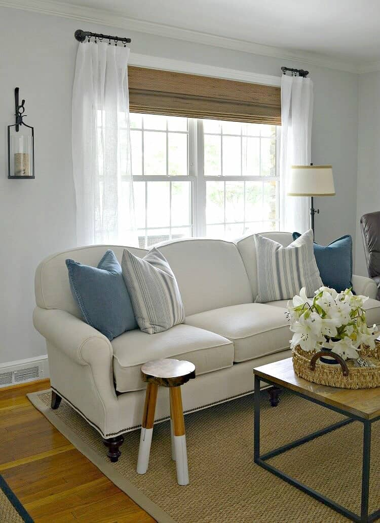 How to easily customize a living room by making DIY curtain rods using black pipe and fittings.