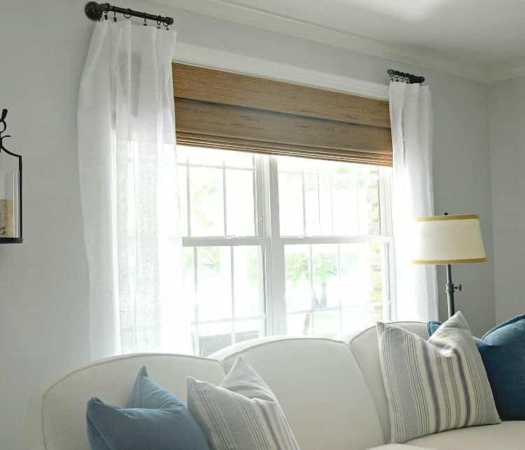 How to customize a living room by making DIY custom curtain rods using black pipe and fittings.