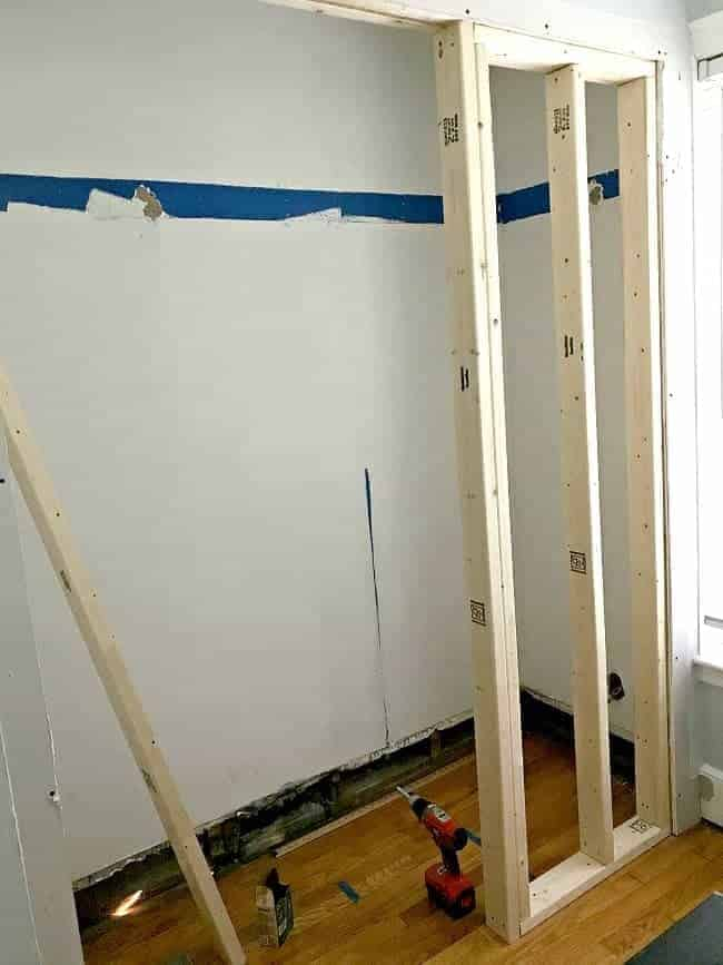 Framing the walls during the small powder room transformation.