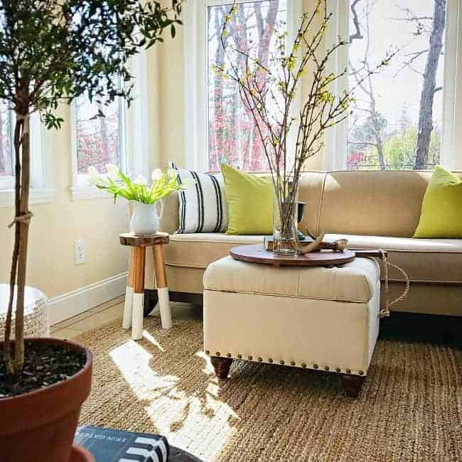 A natural fiber area rug adds texture and warmth to a sunroom, plus it's an inexpensive choice compared to wool rugs.