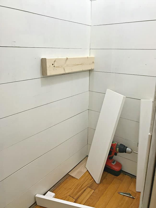 Adding wood planks as we built a small powder room.