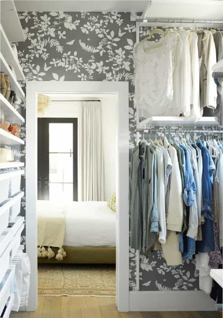 gray flowered wallpaper in large closet