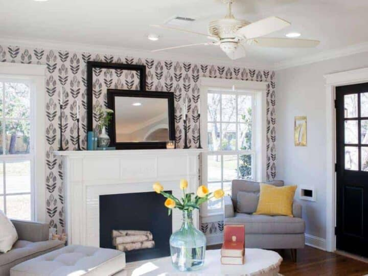 Farmhouse living room with wallpaper on the fireplace wall.