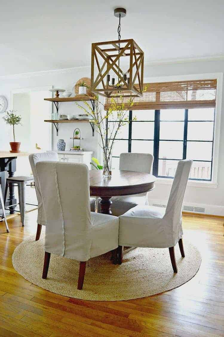Natural fiber area rugs add texture and warmth to a small dining area.
