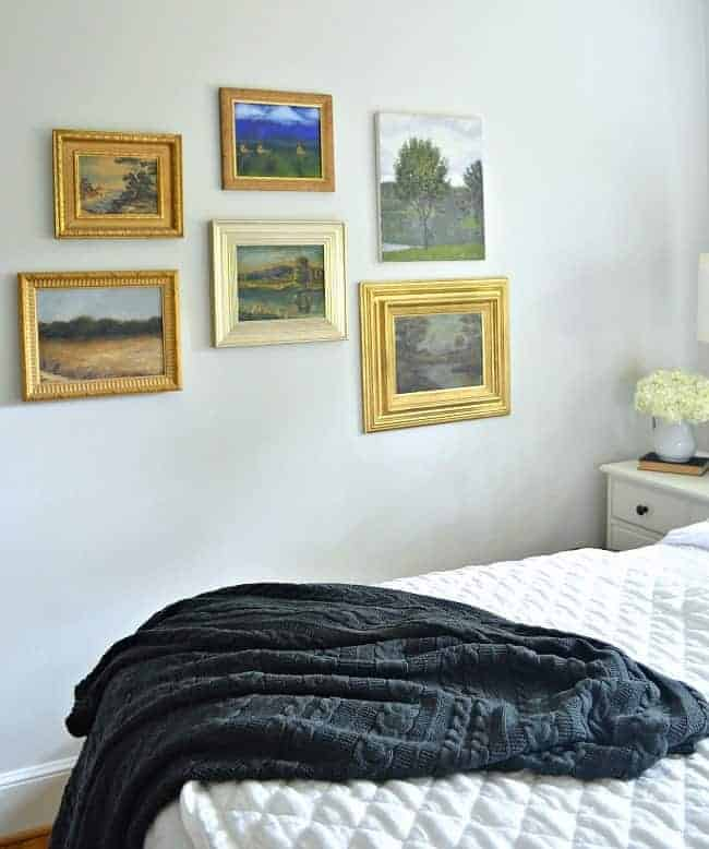 How to use thrift store art to make a gallery wall in any room in your home.
