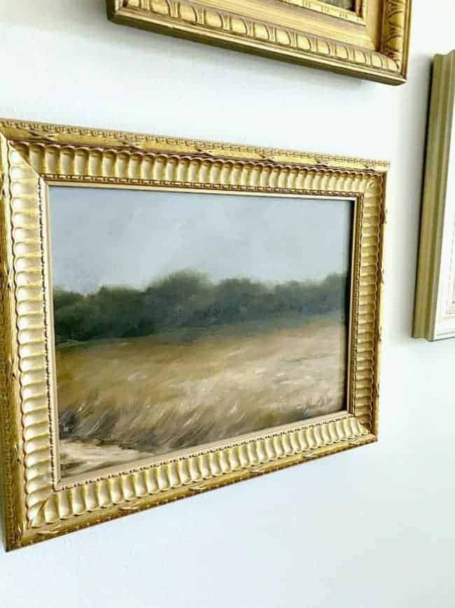How to use thrift store art to make a gallery wall in a master bedroom.