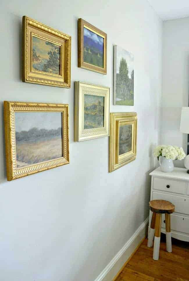 How to use thrift store art to make a gallery wall in any room in your home. A fun way to repurpose old art from thrift stores and flea markets.
