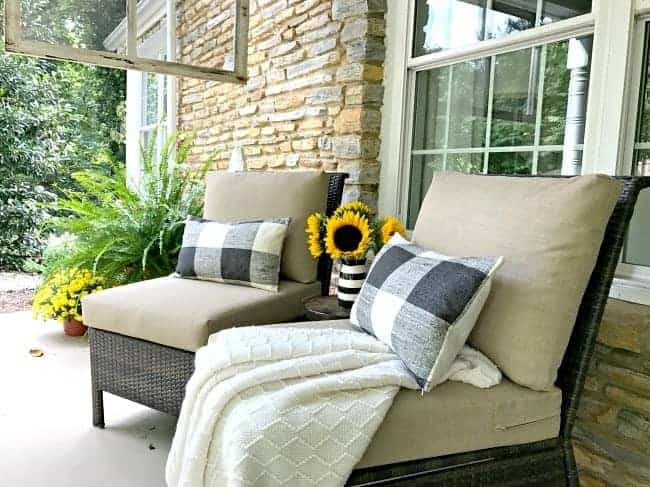 two chairs with pillows on covered porch