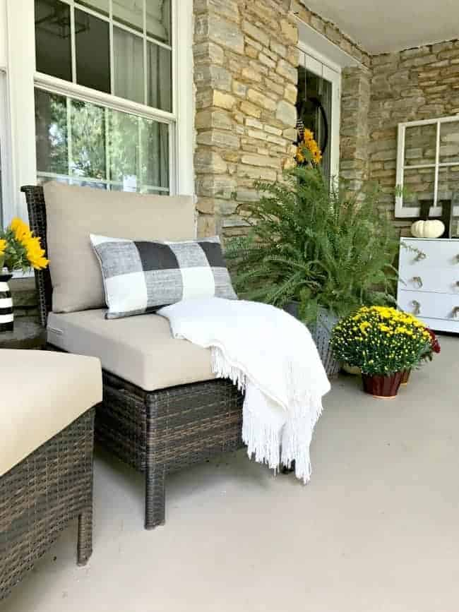 5 tips and decorating ideas for creating a welcoming fall porch for your guests from adding fall color with mums to a cozy seating area