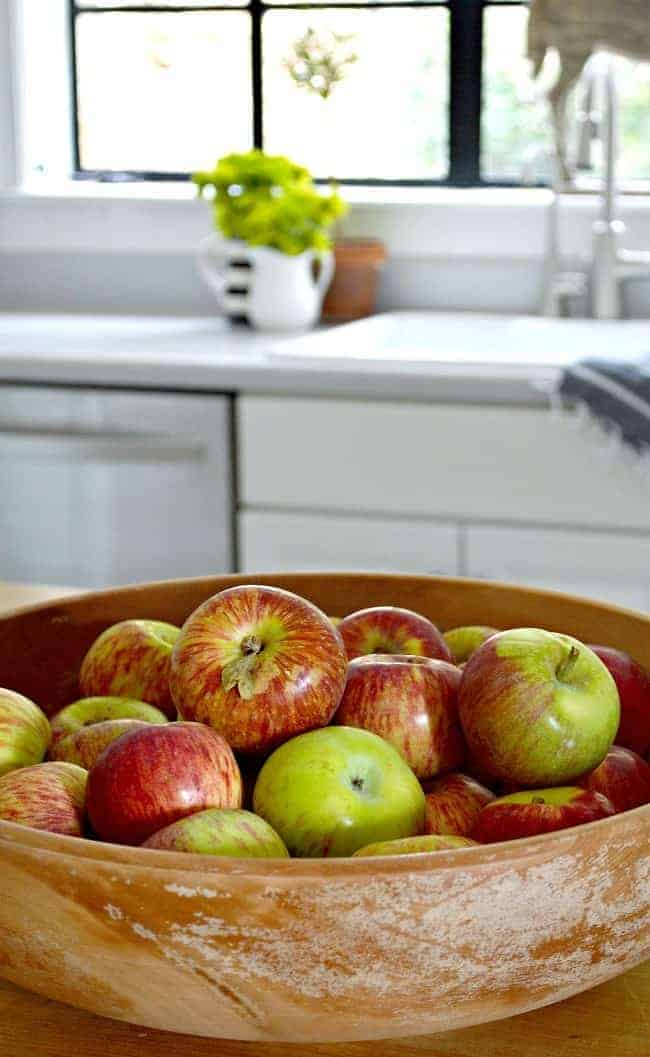 Adding fall touches, including a wooden bowl full of fresh picked apples, around the cottage.