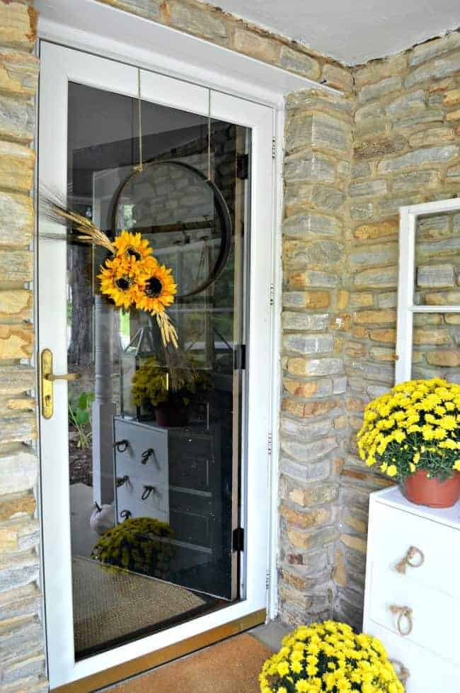 A simple DIY fall front door wreath made with an embroidery hoop and faux flowers.