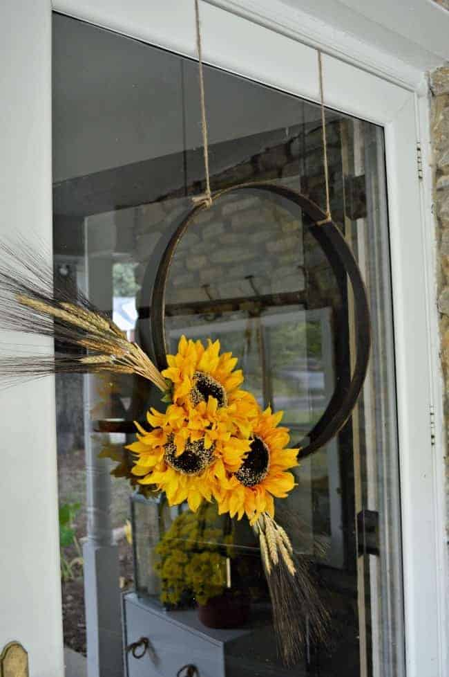 closeup of simple fall hoop wreath hanging on a front door
