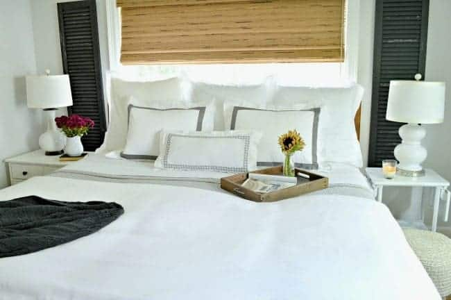 5 tips to create a comfortable and cozy bedroom for fall using candlelight and fresh flowers.