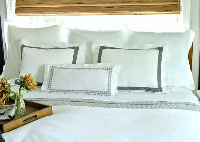 5 tips to create a cozy bedroom for fall, including using lots of pillows.