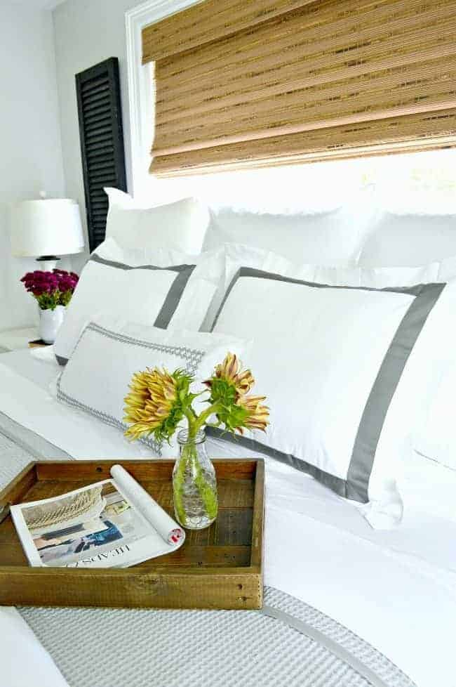 5 tips and ideas to help you create a cozy bedroom for fall using beautiful crisp white linens.