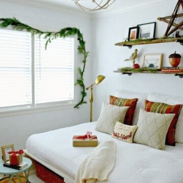A bedroom with a bed decorated for Christmas