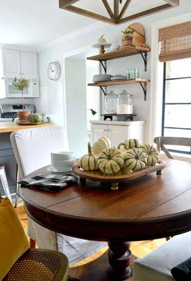 A simple fall centerpiece made with an antique mirror and wood feet. A quick and inexpensive way to add fall color and style to your table.