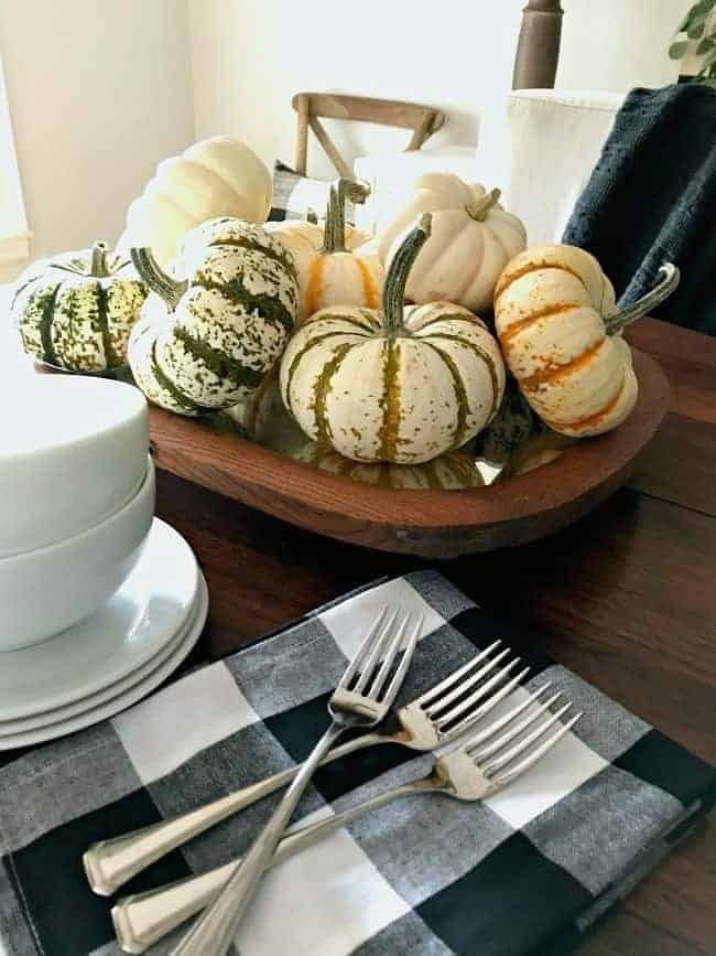 Create this DIY fall centerpiece with pumpkins and a thrifted antique mirror. A thrifty and easy fall decor idea.