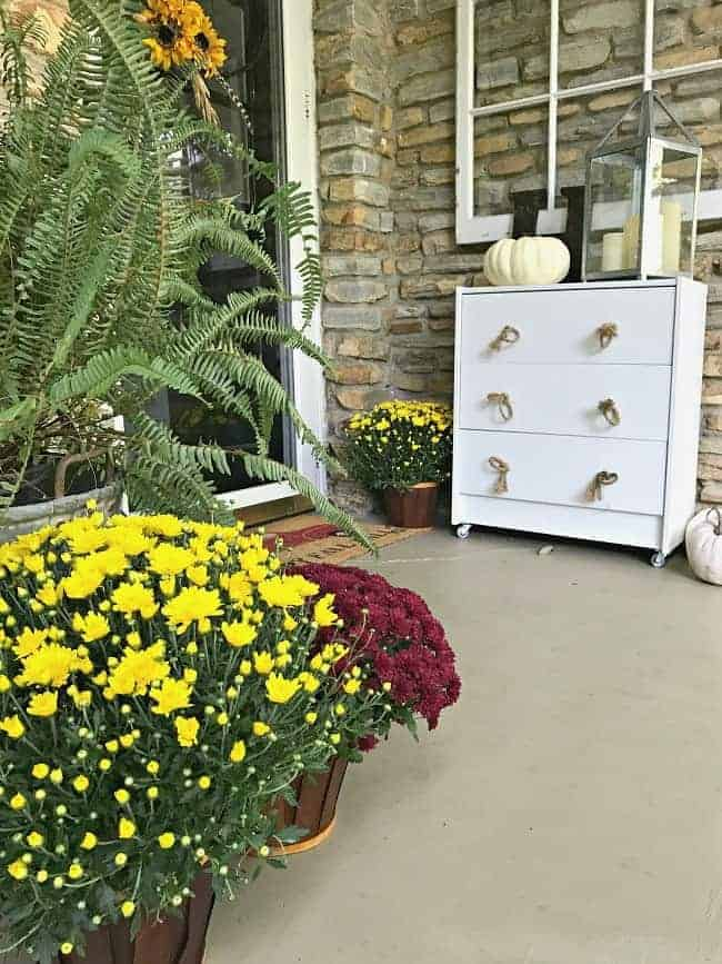 5 easy and inexpensive tips and decorating ideas for creating a welcoming fall porch for your guests from adding fall color with mums, pumpkins and candles.