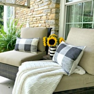 fall front porch with 2 chairs with pillows on them