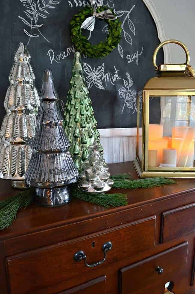 A holiday home tour with 4 blogging friends where I'm sharing our Christmas dining room, decorated with natural elements, mercury glass and rustic glam touches.