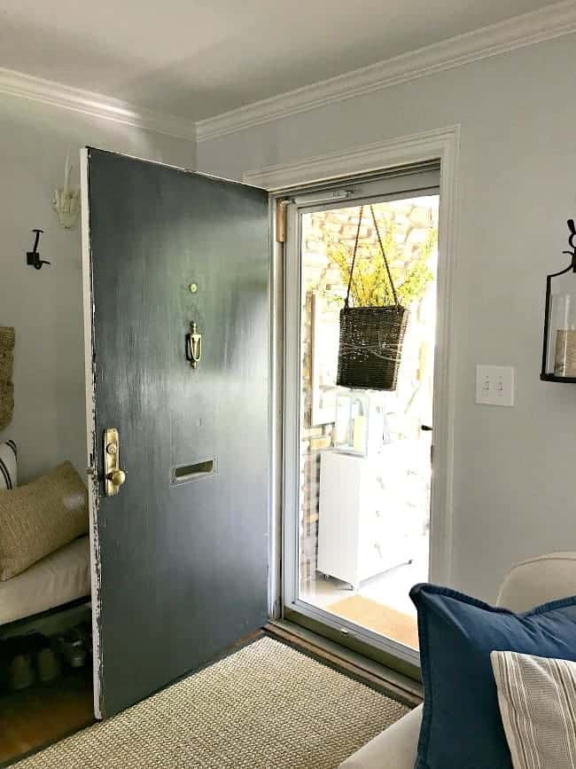 How to use an old thrifted door to make a new front door for a 1946 stone cottage, and painting it a beautiful color, Benjamin Moore Wythe Blue.