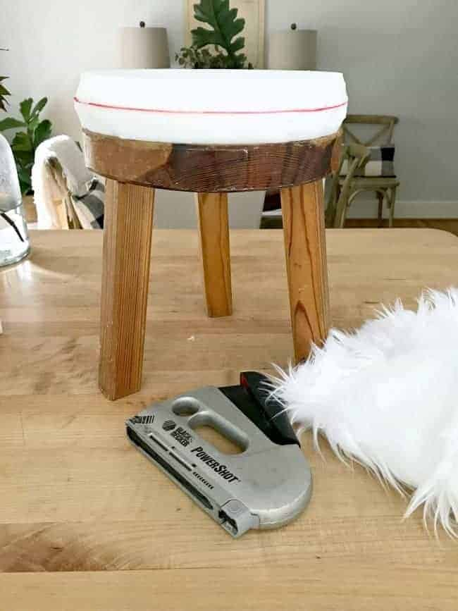 A $2 thrift store find turns into a cool faux fur stool with just a few supplies.