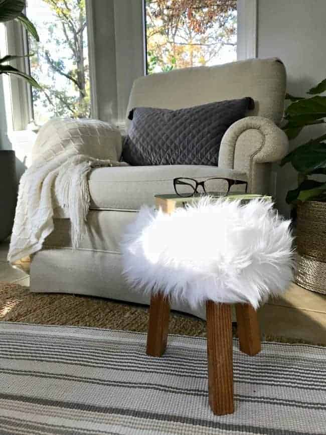 glasses sitting on a small stool with faux fur thrifty decor idea