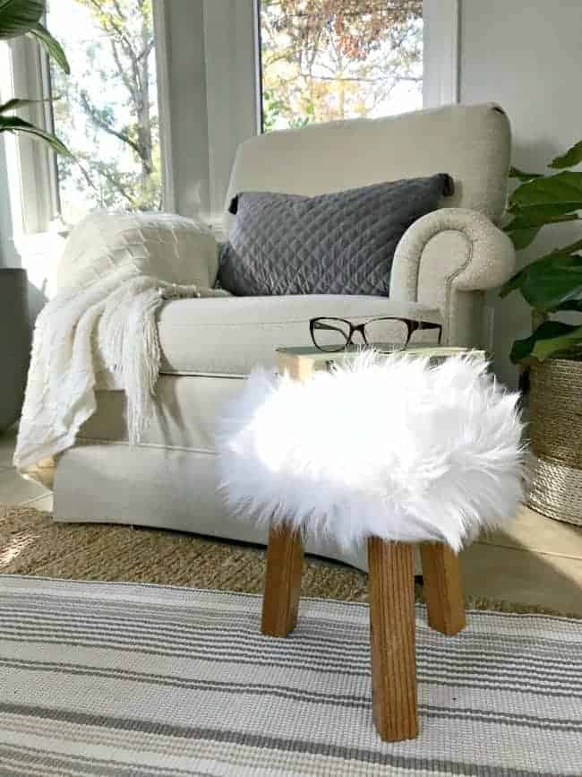 A $2 thrift store find turns into a cool faux fur stool for any room in your home with this easy DIY tutorial.