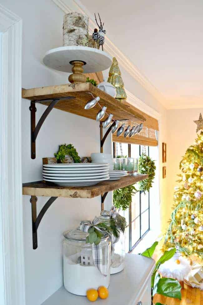 How to create a cozy cottage Christmas kitchen by using farmhouse touches like tons of fresh greenery from the yard.