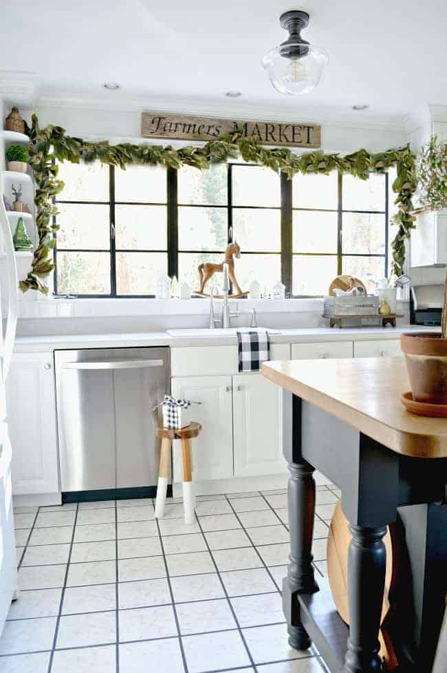 DIY magnolia leaf garland around large kitchen window