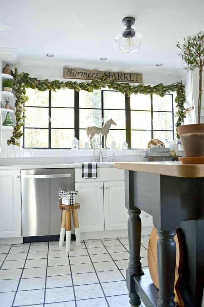 DIY magnolia leaf garland on kitchen window