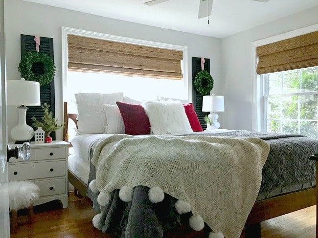 Sharing cottage Christmas decor with a tour of the master bedroom, including some easy Christmas decorating tips.